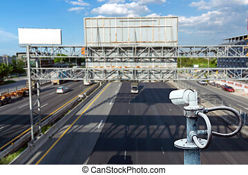 CCTV cameras on the overpass for recording road traffic.