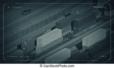 CCTV Cars Passing Railway Yard With Boxcars - CCTV view of...