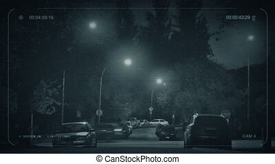 CCTV Cars Passing Through Suburbs At Night - CCTV view of...