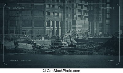 CCTV Diggers Working In City - CCTV view of machines digging...