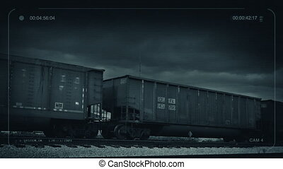 CCTV Freight Train Carriages Pass - CCTV view of freight...