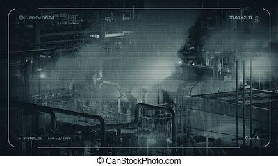 CCTV Industrial Machinery On Rainy Night - CCTV view of...