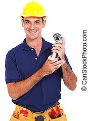 cctv installer holding camera