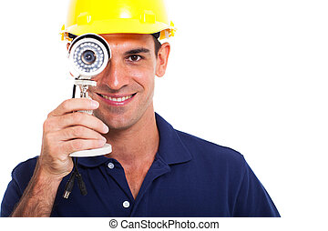 cctv installer looking through camera