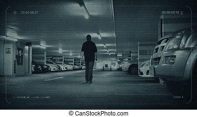 CCTV Man Walks To Car In Parking Garage - CCTV view of man...