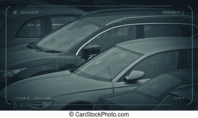 CCTV Parked Cars In Rainy Weather - CCTV view of cars in...