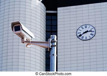 CCTV security camera - CCTV security camera against a city...