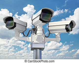 CCTV security camera on cloud sky background.