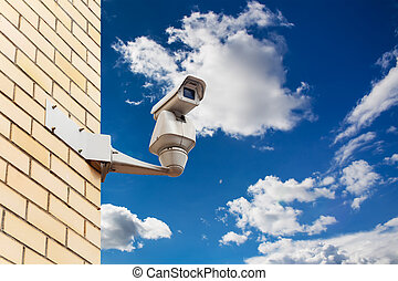 cctv security camera on the wall of building