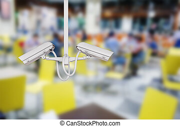 CCTV security camera with restaurant background