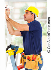 cctv technician adjusting camera angle - professional cctv...
