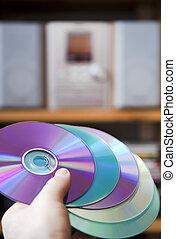 CD audio media - Hand holding CD media in front of hi-fi ...
