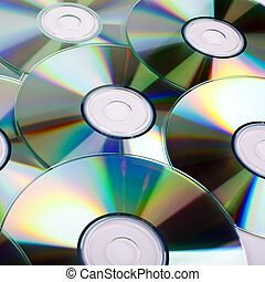 CDs (Compact Discs) laid out on a white background.