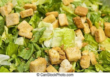 A fresh ceasar salad with romaine lettuce and croutons
