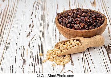 cedar nuts in bowl and scoop