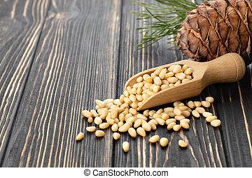 cedar nuts in scoop