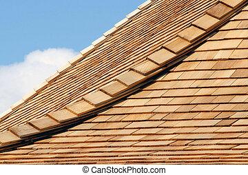 Cedar Shingles - Roof of new cedar shingles - blue sky and...
