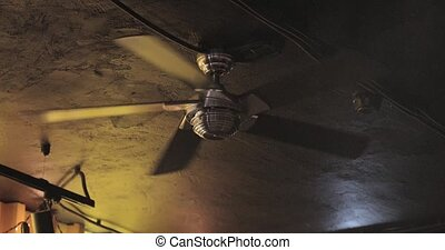 ceiling fan in a dark dark room.