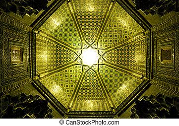 Ceiling in Samarkand - Sun shining though a green mosaic in...