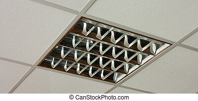 Fluorescent office ceiling lamp on the white ceiling close-up view