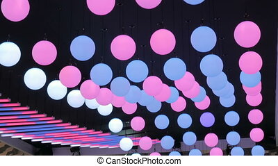 Ceiling moving led balls of three colors - white, blue and...
