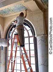 A woman on a ladder, restoring a fresco on a ceiling.