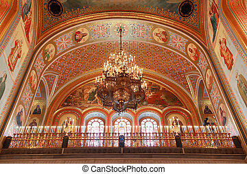 Ceiling with lusters adorned by candles inside Cathedral of Christ the Saviour in Moscow, Russia