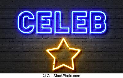 Celeb neon sign on brick wall background.