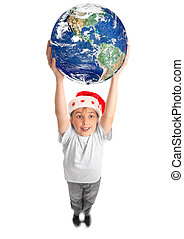 Celebrate Christmas around the World - A smiling joyous boy...