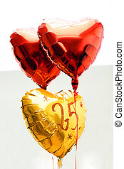 Celebrating 25th years anniversary golden label with ribbon and balloons,