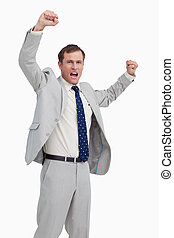 Celebrating businessman with his arms up against a white background