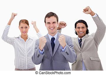 Celebrating businessteam against a white background