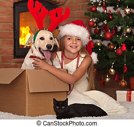 Celebrating christmas with my furry friends - little girl...