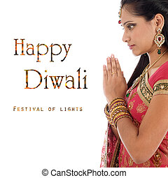 Celebrating Diwali festival - Indian woman in traditional ...