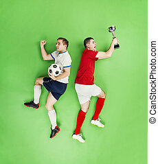 Celebrating football players - Two football players...
