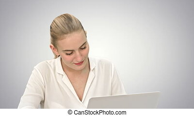 Celebrating success, excited business woman start to dance, working on laptop on white background.