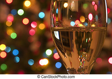 Celebrating the Holidays - Close up on a Wine Glass with the...
