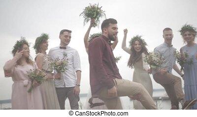 Celebrating wedding pier - Newlyweds guests celebrate their...