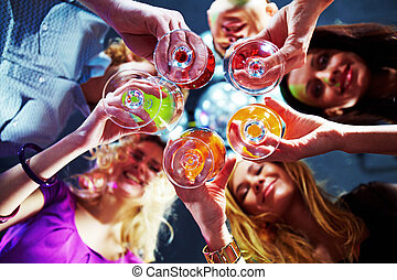 Celebration - Bottom view of many friends holding glasses ...