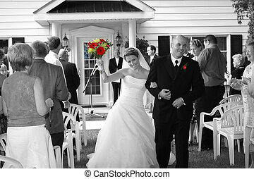 celebration - bride and groom walking down the aisle...
