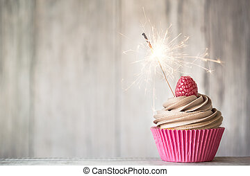 Celebration cupcake - Cupcake decorated with chocolate...