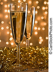 Celebration for two. - Two champagne flutes among golden ...