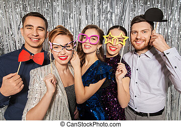 happy friends posing with party props - celebration, fun and...