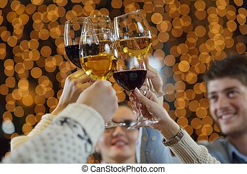 Hands holding the glasses of champagne and wine