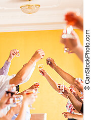Celebration. Hands holding the glasses of champagne and wine making a toast