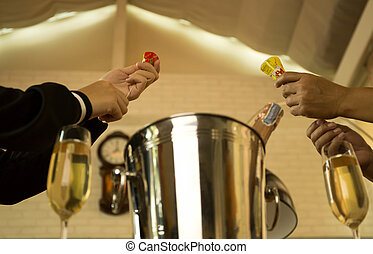 Hands pulling a Christmas and New year pop up cracker with champagne glasses