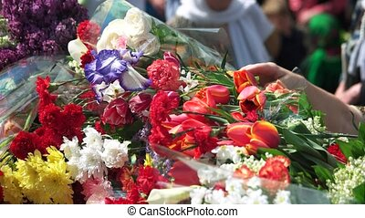 Celebration of may 9, victory day. Close up. Many bouquets...