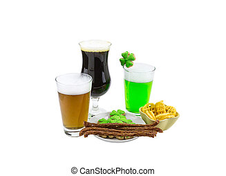 Celebration Patrick saint day beer tasting glass of green wheat lager and a glass of dark stout snack biscuits clover