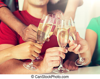 friends clinking glasses of champagne at party