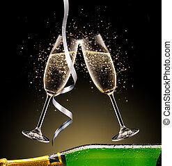 Celebration theme. Glasses and bottle of champagne with bubbles, isolated on black background